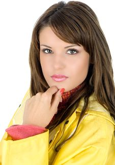 Free Young Woman Posing In Yellow Waterproof Mackintosh Royalty Free Stock Photography - 4983517