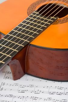 Acoustic Guitar And Sheet Music Stock Images