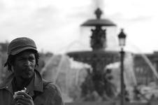 Free Black Man And Fountain In Background Stock Photography - 4990572