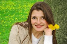 Free Smiling Girl With Yellow Flowers Stock Photos - 4996433