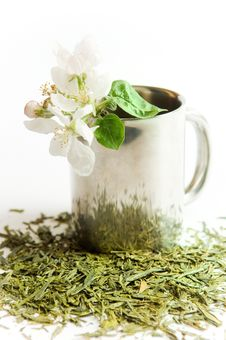 Cup Of Tea With Flower And Tea Leafs Royalty Free Stock Image