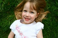 Free Girl In The Grass Royalty Free Stock Photos - 4999528