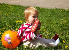 Free Girl With Ball On  Grass Royalty Free Stock Photography - 5000627