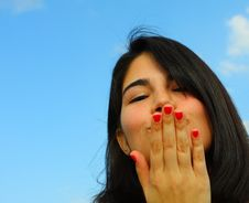 Free Woman Blowing A Kiss Royalty Free Stock Photo - 5005665