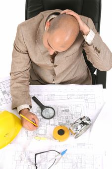 Businessman Thinking With Architectural Plans Stock Photography