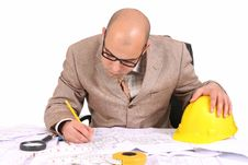 Businessman With Architectural Plans Royalty Free Stock Photos