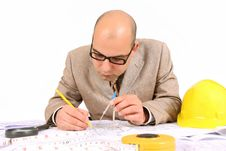 Businessman With Architectural Plans Royalty Free Stock Photography