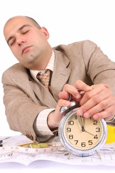 A Businessman Sleepy With Architectural Plans Royalty Free Stock Photography