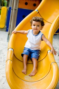 Free Child On Slide Royalty Free Stock Image - 5009906