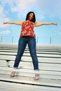 Free Cheerleader On The Bleachers Stock Image - 5015241