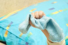 Free The Hand Of The Child And Sock Stock Photos - 5013153