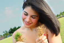 Free Woman Holding Grass Patches Stock Image - 5014971