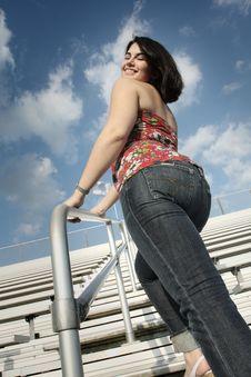 Woman On Bleachers Royalty Free Stock Photos