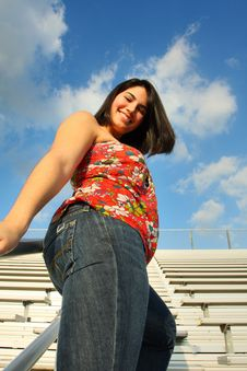 Woman By The Bleachers Stock Photo