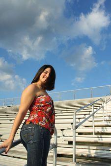 Woman On Bleachers Royalty Free Stock Photo