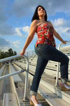 Free Woman On Bleachers Stock Image - 5015081