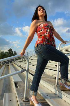 Woman On Bleachers Stock Image