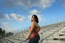 Free Woman On Bleachers Royalty Free Stock Photos - 5015088