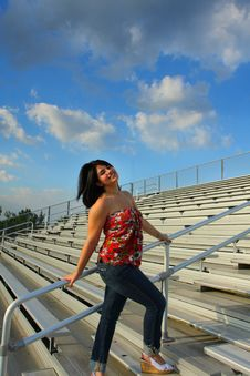 Free Woman On Bleachers Royalty Free Stock Photo - 5015095