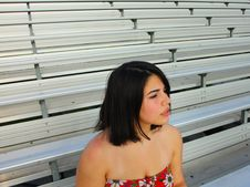 Free Woman Sitting On The Bleachers Stock Photos - 5015183