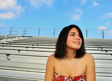 Woman On The Bleachers Stock Photo