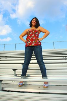 Free Woman Standing On Bleachers Stock Photography - 5015232