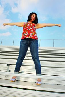 Free Cheerleader On The Bleachers Stock Image - 5015241