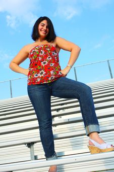 Free Woman Standing On Bleachers Stock Photos - 5015253