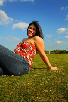 Free Woman Sitting On Grass Stock Photo - 5015430
