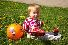 Free Girl With A Ball On A Grass Royalty Free Stock Images - 5017019