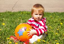 Little Girl With Ball On A Grass Royalty Free Stock Photo