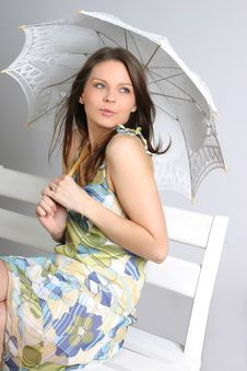 Young Brunette Girl With Umbrella In White Stock Photo
