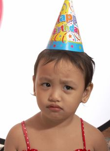 Free Unhappy Child With Party Hat Royalty Free Stock Photo - 5019535