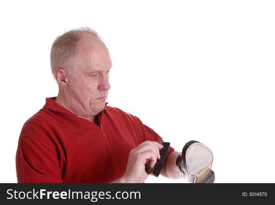 Old Guy in Red Shirt Shining a Shoe