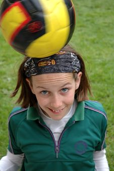 Girl Playing With Ball On Her Head Stock Photography