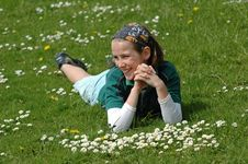 Free Child Lying In The Grass In Spring Royalty Free Stock Images - 5020629