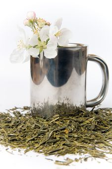 Cup Of Tea With Flower And Tea Leafs Stock Image