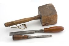 Wooden Mallet And Two Chisels