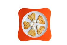 Free Waffles On A Orange Plate Stock Images - 5023524