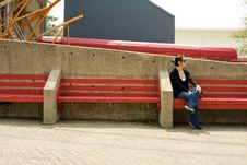 Free Woman On Red Bench Royalty Free Stock Images - 5025679