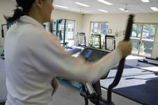 Free Young Girl Running On Treadmill Stock Photos - 5028683