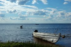 Lake View With Old Fishing Boat And Washing Woman Stock Photo