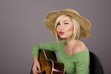 Free Blonde With Guitar Lips Puckered Royalty Free Stock Photos - 5033148