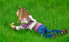 Free Little Girl Walks In The Spring On A Young Grass Stock Photo - 5034800