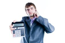 Businessman Showing Calculator With 1000+ Royalty Free Stock Image
