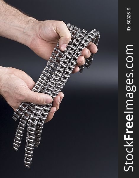 Hands with metal link chain