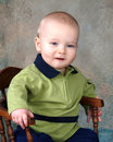 Free Boy On Wooden Chair Royalty Free Stock Photography - 5044067