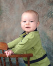 Free Boy Leaning On Wooden Chair Stock Photography - 5048472