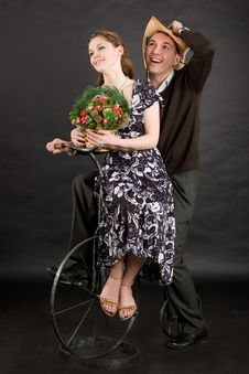 Vintage Happy Couple On A Bicycle Stock Images