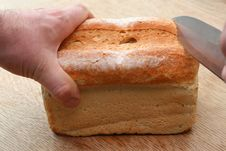 Free Cutting Into Bread Stock Image - 5041311